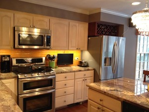 Small_backsplash__knobs__wine_rack_over_fridge