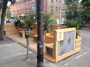 http://evanston.chicagotribune.com/2014/08/01/evanstons-first-parklet-makes-debut-across-hewn-bakery/