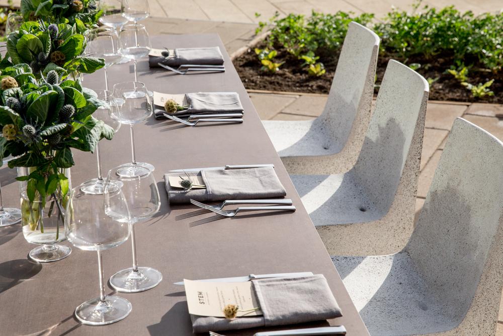 Lightweight concrete chairs, lightweight concrete tables, lightweight concrete  furniture, Lightweight concrete rooftop. - STEM RESTAURANT, SF > EDG INTERIORS Unexpectedly Light Concrete